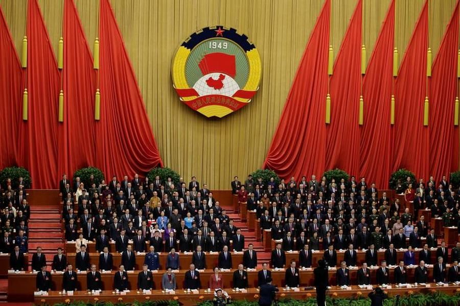 China's leaders sing national anthem as they attend the opening session of the Chinese People's Political Consultative Conference (CPPCC) at the Great Hall of the People in Beijing