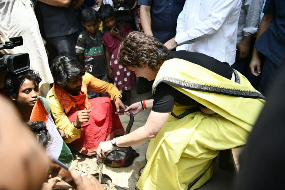 raebareli priyanka gandhi reaches snake charmers colony plays with cobra